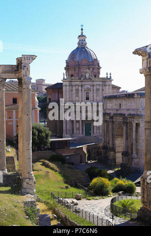Amazing ruins of Roman Forum and church in Rome, Italy. - Stock Photo