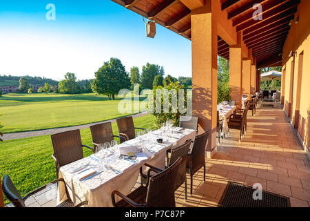 Outdoor restaurant terrace on golf club Le Fonti in Castel San Pietro Terme, Italy - Stock Photo