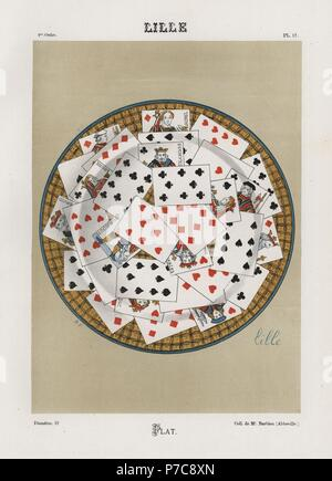 Plate decorated with playing cards from Lille. Hand-finished chromolithograph by Ris Paquot from his General History of Ancient French and Foreign Glazed Pottery, Chez l'Auteur, Paris, 1874. - Stock Photo