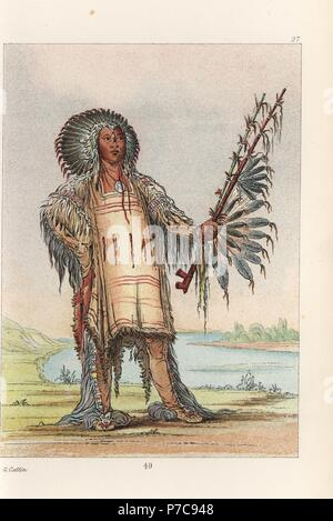 Ha-na-tah-nu-mauh, Wolf Chief, head chief of the Mandan people, in dress of skins and headdress of raven quills. Handcoloured lithograph from George Catlin's Manners, Customs and Condition of the North American Indians, London, 1841. - Stock Photo