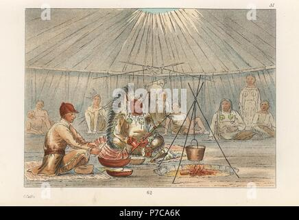 The second chief of the Mandan, Mah-to-toh-pa, Four Bears, in his teepee with George Catlin enjoying buffalo ribs, turnip pudding and buffalo berries. Handcoloured lithograph from George Catlin's Manners, Customs and Condition of the North American Indians, London, 1841. - Stock Photo