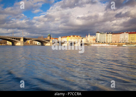 View on the Prague panorama with Jirasek bridge after rain.The Prague bridges arching over the Vltava River are not only vital connecting links, but a - Stock Photo