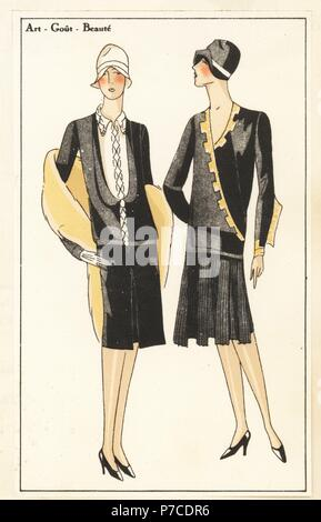 Woman in afternoon dress of black crepe, and woman in pleated dress of black crepe de chine. Handcolored pochoir (stencil) lithograph from the French luxury fashion magazine Art, Gout, Beaute, 1927. - Stock Photo