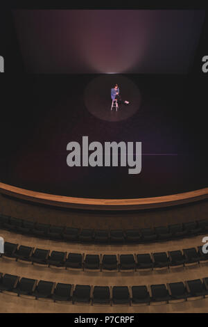 Actress performing acting on stage - Stock Photo