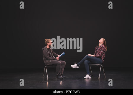 Male and female actress performing play on stage - Stock Photo