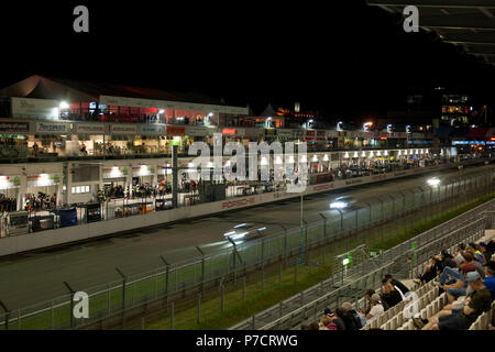 Nuerburgring, race track at night, grandstand with spectators, race cars, racing, night view, Eifel, Rhineland-Palatine, Germany, Europe - Stock Photo