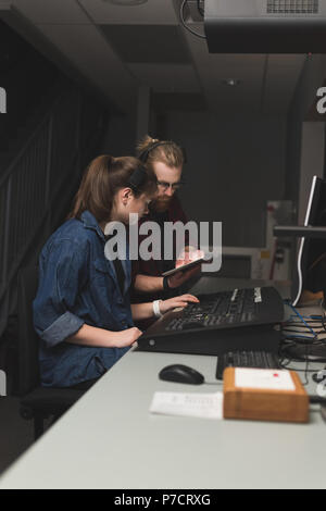 Two sound recorder using digital tablet in studio - Stock Photo