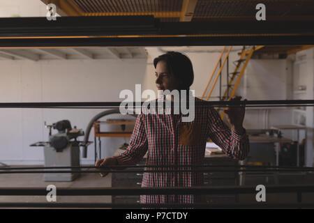 Female welder working in workshop - Stock Photo