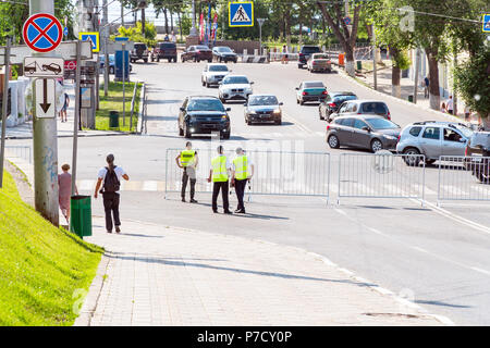 Group of police standing at crossroads - Stock Photo