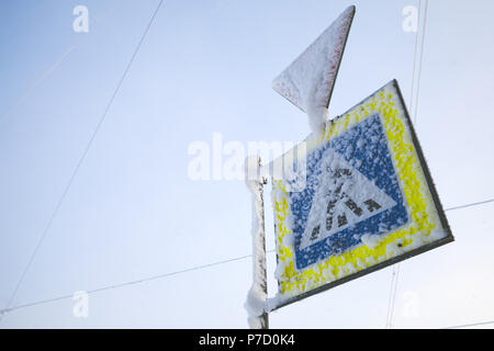 Pedestrian Srossing and Give way, road signs covered with wet snow - Stock Photo