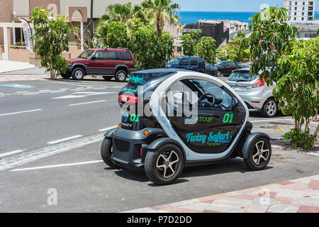 Spain, Tenerife - May 08, 2018: Twin Renault Twizy car is parked in a city street - Stock Photo