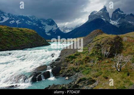 At the Salto Grande del Rio Paine, mountain peaks of Cuernos del Paine at the back, Torres del Paine National Park - Stock Photo