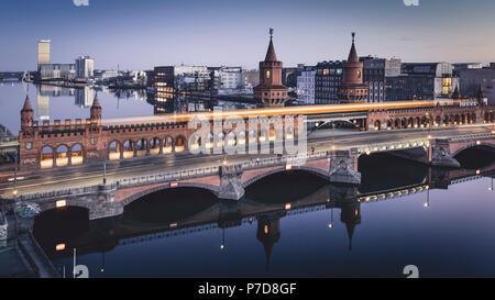 Evening view of the Oberbaum Bridge in Berlin, Berlin, Germany - Stock Photo
