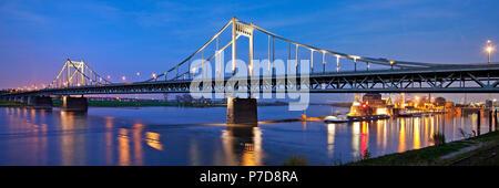 Rhine bridge between Duisburg-Mündelheim and Krefeld-Uerdingen with Rhine harbour in the evening, Krefeld - Stock Photo
