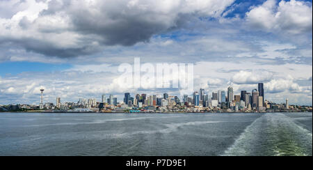 Seattle skyline seen from a Washington State ferry boat in the Puget Sound on a cloudy sunny day, WA, USA. - Stock Photo