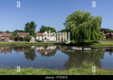 A view across the duck pond in the picture postcard village of Nun Monkton; North Yorkshire, UK - Stock Photo