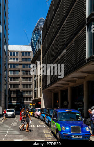 A Row Of Traditional London Taxis Outside Fenchurch Street Station, London, United Kingdom - Stock Photo