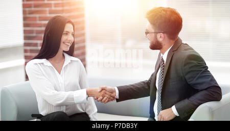 handshake of manager and client sitting in the office lobby. - Stock Photo