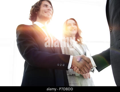 Photo of handshake of two happy businessmen - Stock Photo