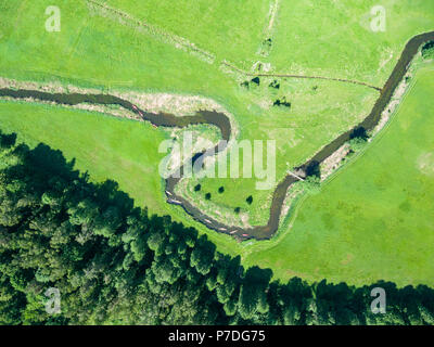 Aerial view of canoes on Rospuda river on a sunny day, Poland - Stock Photo