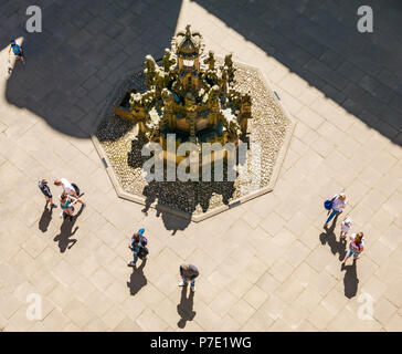 Looking down to central courtyard with ornate stone fountain with people's shadows in Summer sunshine, Linlithgow Palace, West Lothian, Scotland, UK - Stock Photo