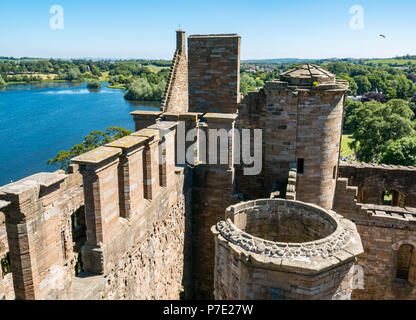 View of loch and Peel grounds from tower top on Summer day with blue sky, Linlithgow Palace, West Lothian, Scotland, UK - Stock Photo