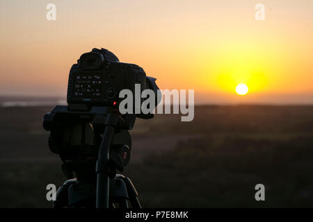 Canon 5D Digital SLR camera taking a sunrise timelapse, Corfe Castle, Dorset, UK - 29th April 2018 - Stock Photo