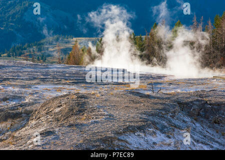 Mammoth Hot Springs in Yellowstone National Park in Wyoming. The main attraction at Mammoth Hot Springs is the terraces. - Stock Photo