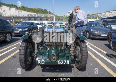 Green 1934 MG sportscar. This is a 2 rigid axle 1086cc petrol driven vintage car waiting to board a car ferry from Dover to Calais - Stock Photo