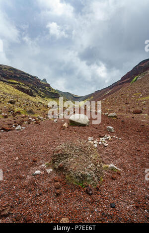 rocks and stones in red volcanic crater,mount tarawera,new zealand - Stock Photo