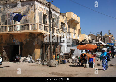 Decrepit house and typical scene on the street in Saint-Louis-du-Sénégal - Stock Photo