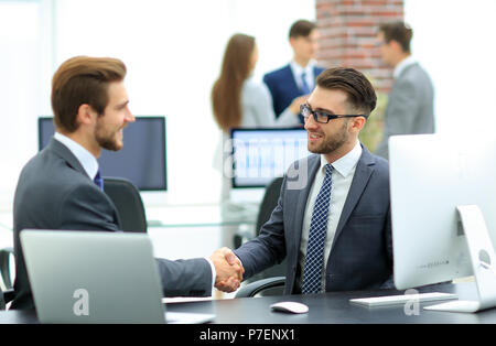 Successful managers shaking hands after closing deal in office - Stock Photo