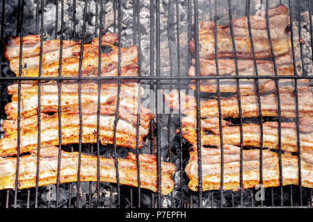 Grilled pork belly on the grill. Barbecue in the nature at summer. - Stock Photo