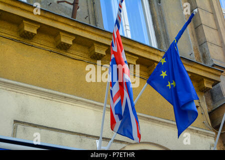 EU and UK flags coalition together. European Union and United Kingdom flags next to each other. - Stock Photo