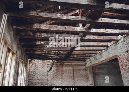 Wooden beam structure in the abandoned object. - Stock Photo