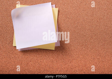 Various colors several sticky post notes on cork background - Stock Photo