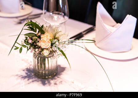 flowers settings decoration outdoor setup for a wedding with pink colored flower - Stock Photo