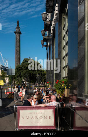 People sitting outside in afternoon sunshine in Amazon restaurant on George Street, Edinburgh, Scotland, UK - Stock Photo