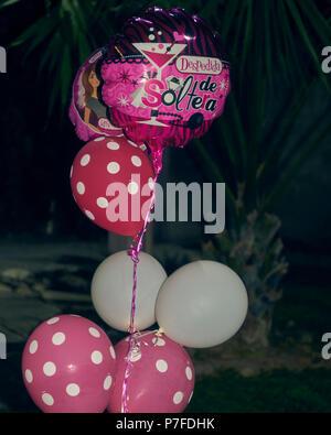Seven balloons at a bacherolette party - Stock Photo