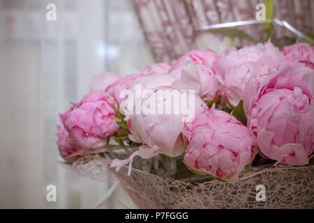 Elegant bouquet of a lot of peonies of pink color close up. Beautiful flower for any holiday. Lots of pretty and romantic flowers in floral shop. - Stock Photo
