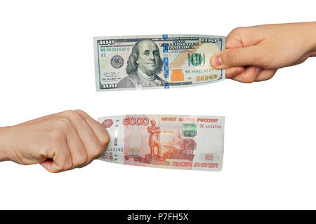 Hands exchange rubles for dollars. People exchange currency, hands transmit money. Hand holds ruble and dollar banknotes. Isolated on white background - Stock Photo