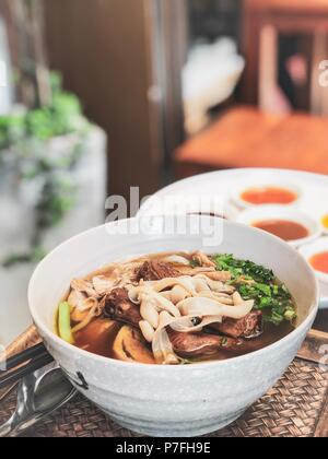 Chinese Roast Duck Noodle Soup Recipe on wooden table - Stock Photo