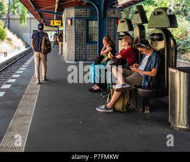 Berlin Dahlem-Dorf U-Bahn railway station on the U 3 line, platform with  unusual seating, Male & Female Bench design by Berlin artist Wolf van Roy. S - Stock Photo