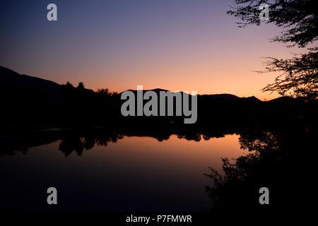 The Kunene River near the Epupa Falls at dawn, Kaokoveld, Namibia - Stock Photo