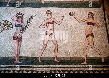 Floor mosaic of three women in bikini, Hall of the Bikini Girls, Villa Romana del Casale, Roman villa from the 4th century AD - Stock Photo
