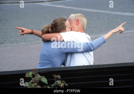 Different views, kissing couple shows in different directions, Berlin, Germany - Stock Photo