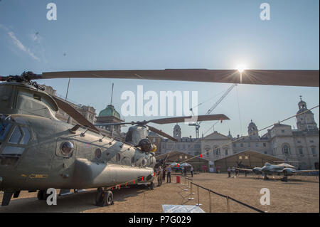 Horse Guards Parade, London, UK. 6 July, 2018. RAF100, an exhibition of aircraft covering the RAF's history, from WW1 and WW2 through to the modern age are displayed at Horse Guards Parade in central London, open to the public from 11.00am on 6th till 9th July 2018. General view of the parade ground in warm early morning sunlight. Credit: Malcolm Park/Alamy Live News. - Stock Photo
