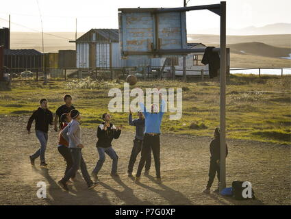 Russia. 24th June, 2018. CHUKOTKA, RUSSIA - JUNE 24, 2018: Children playing basketball by a secondary school in the Lorino whaling settlement. There are 1200 people living in the village which is the centre of Russia's subsistence whaling and walrus hunting. Lorino maritime hunters have an annual catch limit of 60 gray whales and 1 bowhead whale. Yuri Smityuk/TASS Credit: ITAR-TASS News Agency/Alamy Live News - Stock Photo