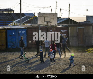 Russia. 24th June, 2018. CHUKOTKA, RUSSIA - JUNE 24, 2018: Children playing basketball in the Lorino whaling settlement. There are 1200 people living in the village which is the centre of Russia's subsistence whaling and walrus hunting. Lorino maritime hunters have an annual catch limit of 60 gray whales and 1 bowhead whale. Yuri Smityuk/TASS Credit: ITAR-TASS News Agency/Alamy Live News - Stock Photo