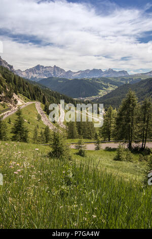 A landscape view over Corvara in Badia Colfosco from Gardena Pass in the Dolomites mountains alps South Tyrol Trentino Alto Adige Italy Europe - Stock Photo